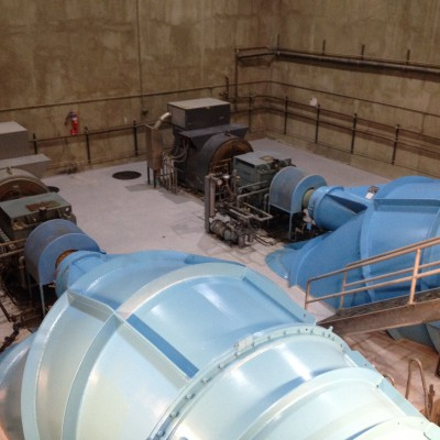 Turbine runners (blue), speed increasers, and generators.